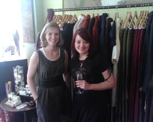 Becky Sullivan and Bee from Bee's Fashion Buzz standing in front of Sullivan's fashion collection.